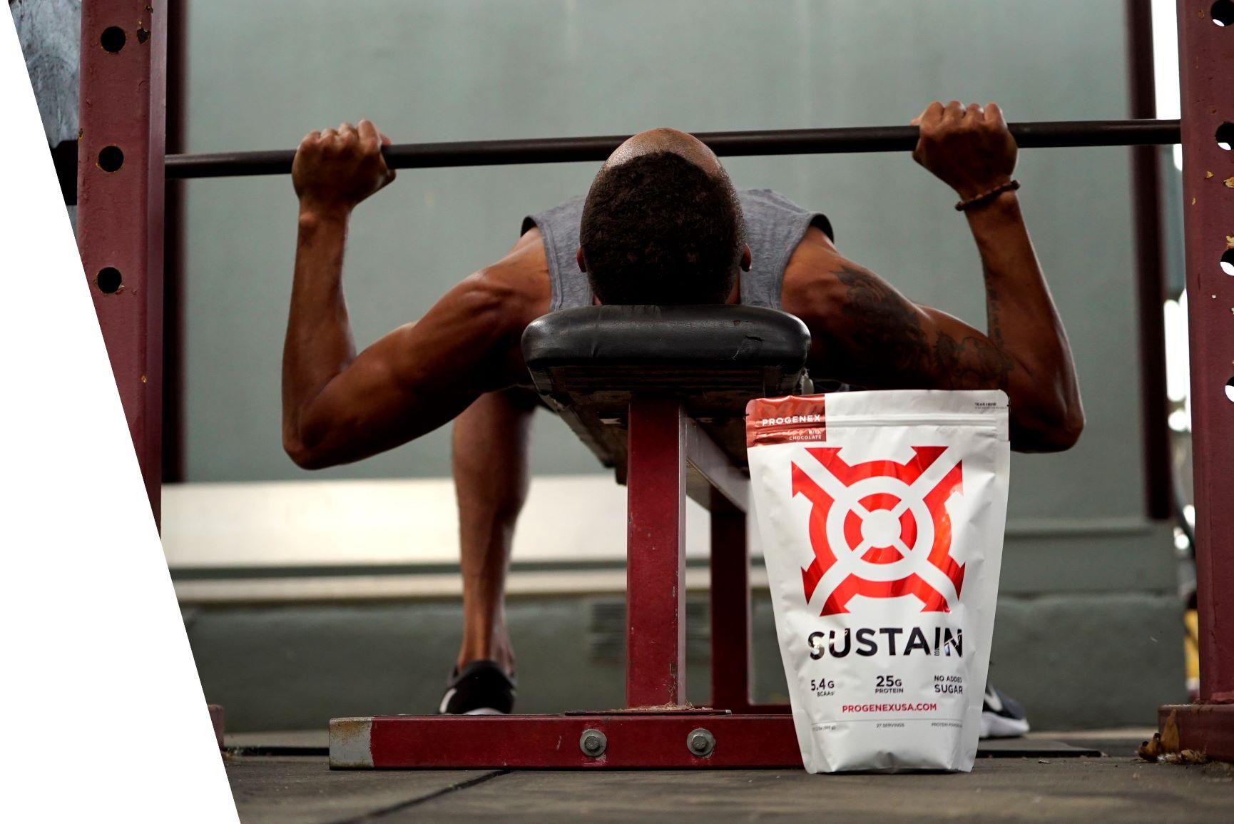 Protenex_whey_protein_isolate_Sustain_next_to_bench_press_athlete