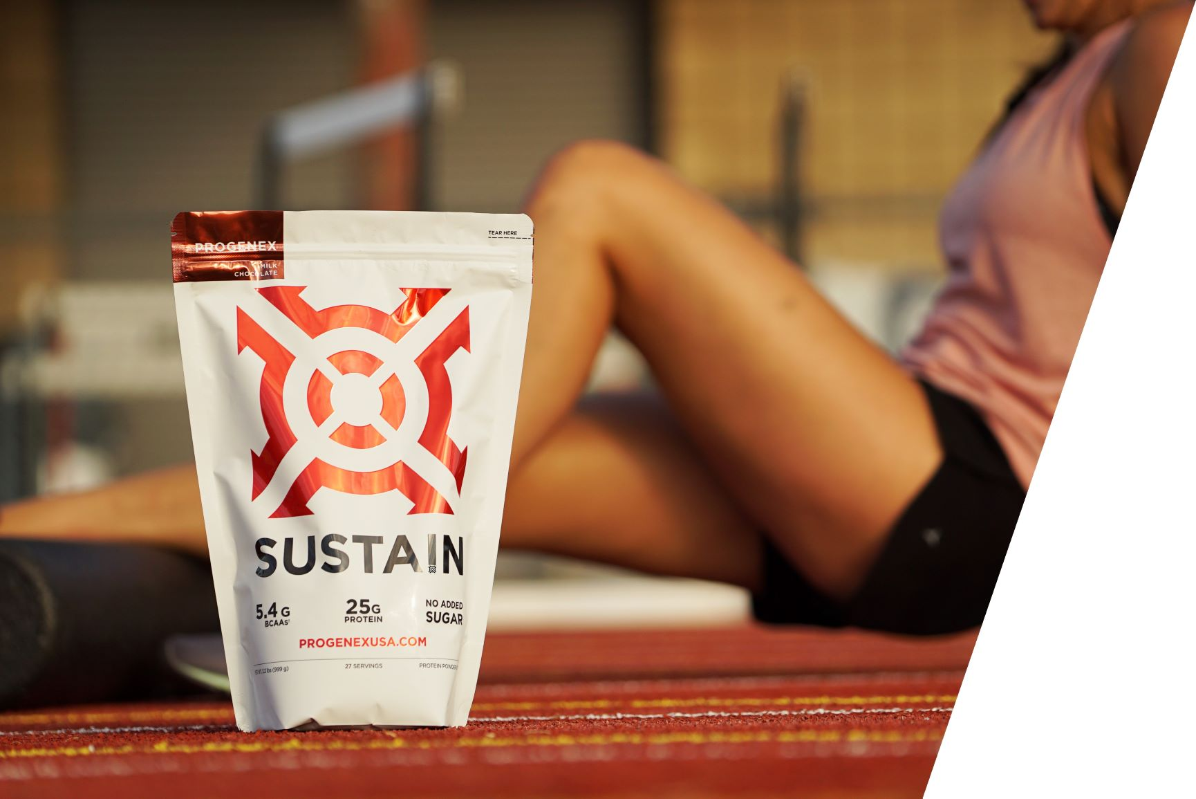 Protenex_whey_protein_isolate_Sustain_next_to_female_athlete_recovering_from_running_on_the_track